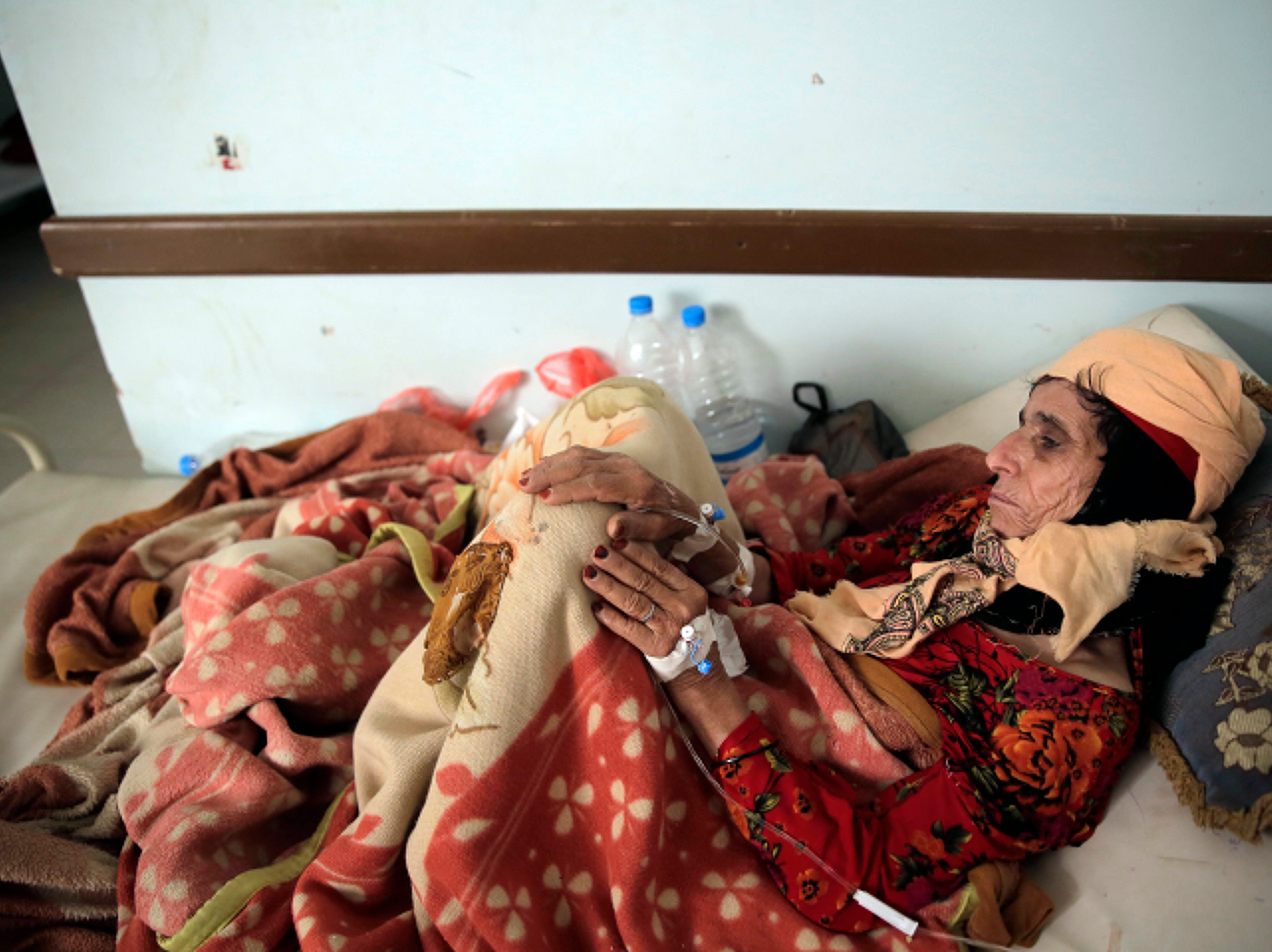 An elderly woman is treated for suspected cholera infection at a hospital in Sanaa, Yemen, Thursday, March 28, 2019. A United Nations humanitarian agency said on Monday that Yemen has witnessed a sharp spike in the number of suspected cholera cases this year, as well as increased displacement in a northern province.