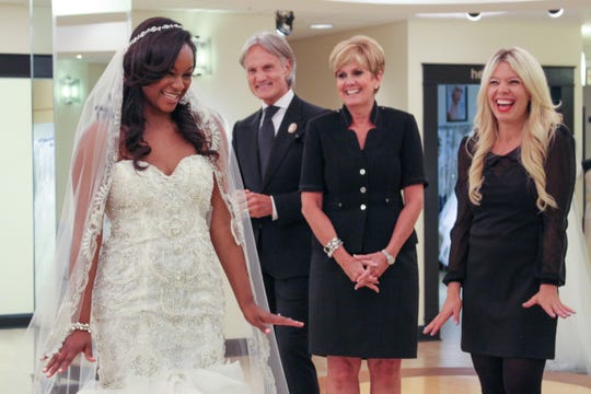 "Taylor tries on a wedding dress with Monte Durham, Lori Allen and an assistant in ""Say Yes to the Dress: Atlanta."""