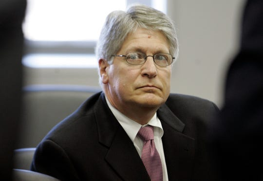 Former Durham County district attorney Mike Nifong listens during a North Carolina state bar hearing in 2007. Nifong was jailed and disbarred for misconduct in a high-profile case.