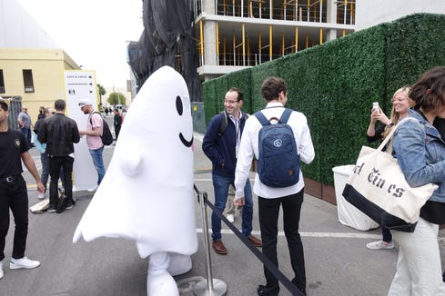 A costumed character welcomes visitors at Snapchat's Partner Event in Los Angeles