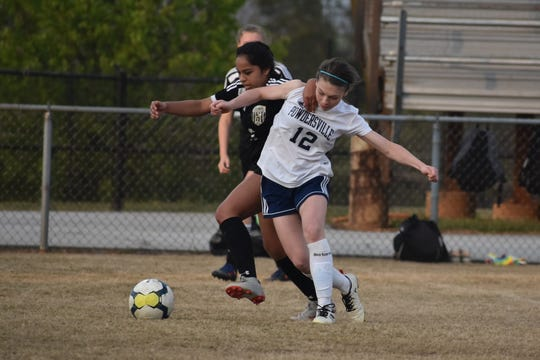 Powdersville freshman forward Sydnee Barrett battles a defender as Powdersville works their way to a 1-0 victory at Greer on Friday, March 29, 2019.