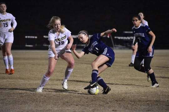 Powdersville senior center back Bry Thobe redirects a ball as Powdersville defeats Pendleton 10-0 on March 7, 2019.