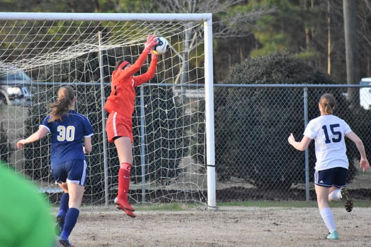Powdersville senior goalkeeper Jeanette Campbell stops a high ball at Seneca as Powdersville earns a 3-0 shut-out on March 11, 2019.