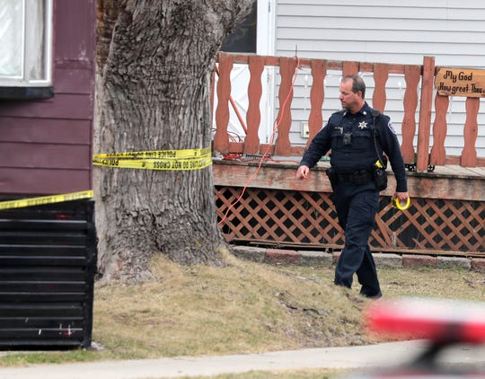 Appleton police investigate a potential shooting in the 100 block of Prim Rose Lane near the intersection of Prim Rose and Oneida Street on Friday in Appleton.