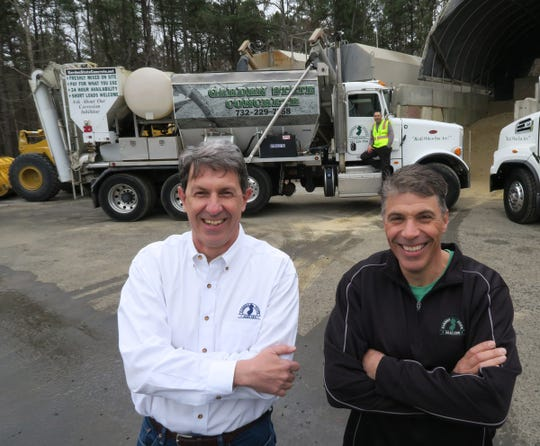 Garden State Concrete owner Richard Manners (left) and his co-owner Robert Fell are shown with some of their concrete mixing trucks at their Tinton Falls business Friday, April 5, 2019.