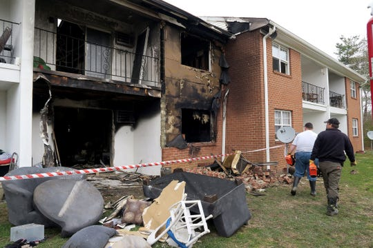 Investigators are shown Friday morning, April 5, 2019, as they continue to examine a fire scene at Building 22 in the Jamestowne Village Apartments in Toms River.