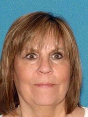 Linda Cainzos has been charged with theft by deception for allegedly submitting bogus invoices for two claims.