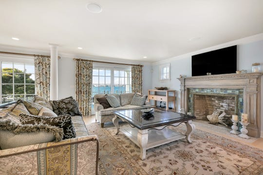 The family room offers an amazing fireplace with a set of french doors.