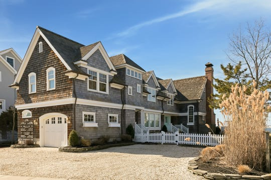 The historic home at 918 North Lagoon Lane in Mantoloking stuns pristine curb appeal.