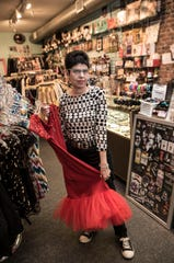 Backward Glances is a Asbury Park business that sells vintage items ranging from clothing to trading cards. Owner Cindy Wolfson Ciullo poses in her shop.