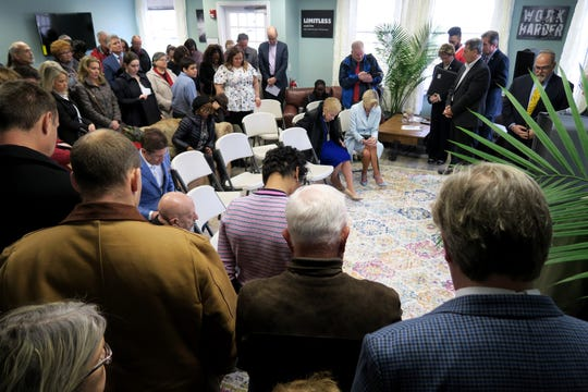 People pray after the ribbon-cutting for the new Family Promise emergency shelter on the old Fort Monmouth property in Oceanport Friday, April 5, 2019.