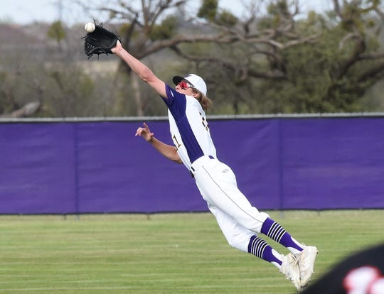 Wylie second baseman Tyler Martin (31) jumps to catch a line drive against Aledo at Bulldog Field on Friday, April 5, 2019.