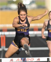 Wylie's Madison Latham clears a hurdle en route to winning the 300-meter hurdles at the District 4-5A track and field meet Thursday, April 4, 2019, at Aledo's Bearcat Stadium. Latham won the event with a 47.07, while teammates Rosia Collins (48.65) and Ambria Brekke (48.96) were second and third, respectively. Cooper's Sarah Ornelas was fourth (49.00).