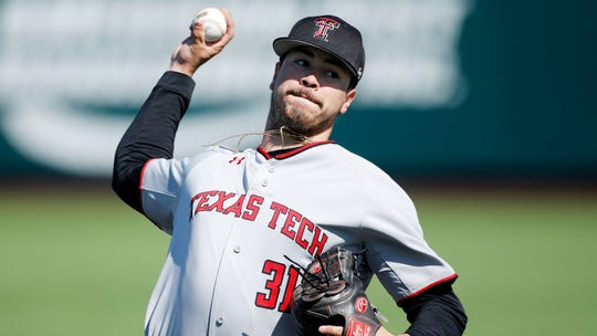 Texas Tech's Caleb Freeman throws a pitch against Kansas State on March 31 in Manhattan, Kan.