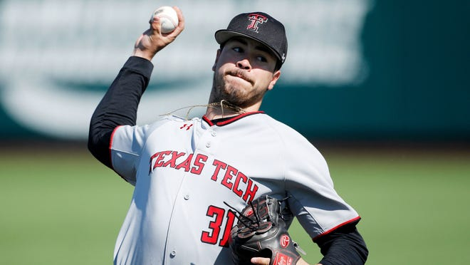 Texas Tech's Caleb Freeman throws a pitch against Kansas State on Sunday, March 31, 2019, in Manhattan, Kan.