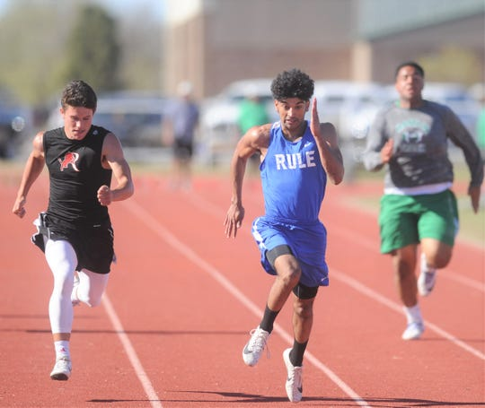 Rule senior Chase Thompson, center, sprints toward the finish line ahead of Roby's Kaige Covington, left, and Hamlin's Austin Lozano in the 100-meter dash at the District 14-1A track meet Thursday, April 4, 2019, at Hamlin High School.