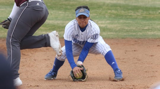 Snyder grad Lindzi Clemmer, a senior at Lubbock Christian, scoops a ground ball during a game this season.