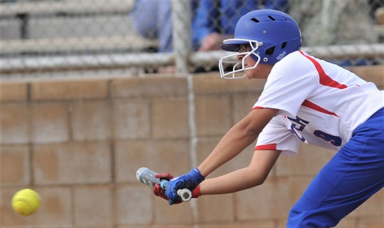 Coopers Destiny Martinez bunts for a single in the second inning against Wichita Falls Rider. Cooper beat the Lady Raiders 10-0 in five innings in the District 4-5A game Friday, April 5, 2019, at Cougar Diamond.