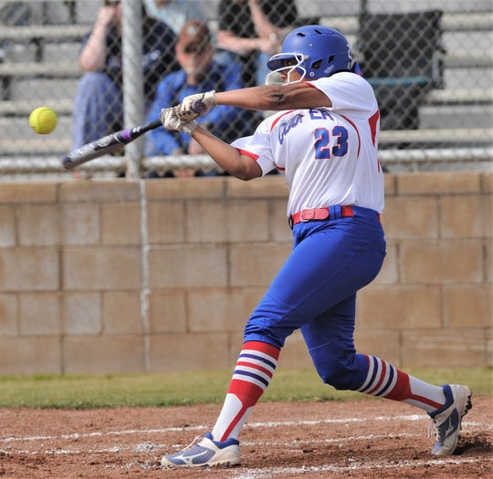 Cooper's Jennika Willis hits an RBI single in the second inning against Wichita Falls Rider. Cooper beat the Lady Raiders 10-0 in five innings in the District 4-5A game Friday, April 5, 2019, at Cougar Diamond.