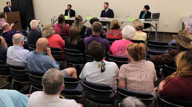 A audience of close to 40 attended Thursday's Hispanic Leadership Council debate the Mockingbird Lane branch of the Abilene Public Library. Place 5 candidates, from left, Kyle McAlister, Cory Clements and Cynthia Alvidrez answered questions from moderator Kevin Pantoja, top left.