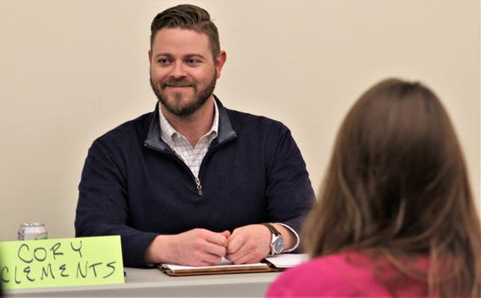 Abilene City Council Place 5 candidate Cory Clements smiles after his opening remarks at Thursday's Hispanic Leadership Council debate the Mockingbird Lane branch of the Abilene Public Library.