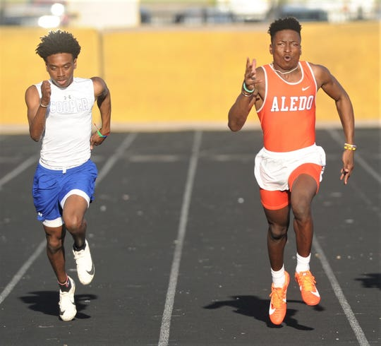 Cooper's Keitron Boyd, left, battles Aledo's Monterren Parks in the 200 meters. Parks won the race in 22.54 seconds, followed by Boyd (22.63) at the District 4-5A track and field meet Thursday, April 4, 2019, at Aledo's Bearcat Stadium.