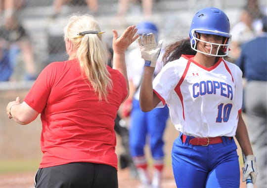 Cooper leadoff hitter Keiana Kemp, right, is congratulated by coach Stacey Herring after scoring the game's first run on Aliayah Martinez's double in the first inning against Wichita Falls Rider. Cooper beat the Lady Raiders 10-0 in five innings in the District 4-5A game Friday, April 5, 2019, at Cougar Diamond.