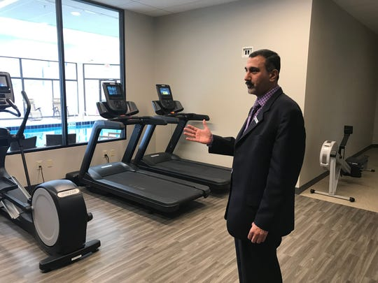 The McCamly Plaza Hotel has a new fitness center on the first floor. General Manager Nauman Choudhry shows off some of the new equipment.