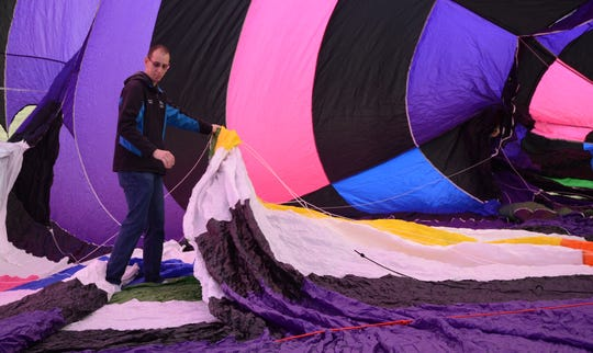 Tyler Jaques checks the inside of the balloon before the flight.