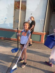 Brynn Vinsevich sweeps up a pile of dirt during a cleanup day. She and her sister, Braedyn, are  the youngest volunteers for the Broome County Cleanup Crew.