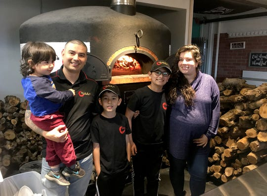 The Barrios family (left to right) Alejandro, 2, David Barrios, Santiago, 8, Miguel, 11, and David's wife, Catalina, at their M*A*S*A Pizza in Port Orchard.