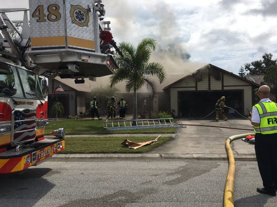Rockledge fire crews battling a house fire on Byrd Court Friday afternoon.