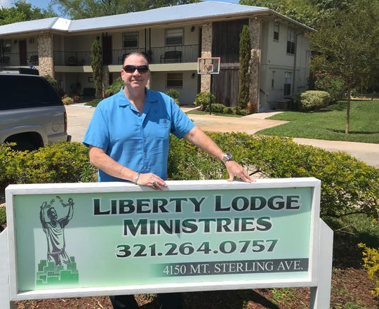 Behind Pastor David Cox is the residence for the men seeking help from addiction through Liberty Lodge ministries.