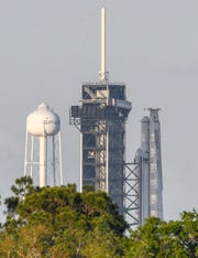 A SpaceX Falcon Heavy rocket sits upright on Pad 39A at Kennedy Space Center Thursday evening.  Preparations continue toward a launch of the rocket no earlier than Sunday.