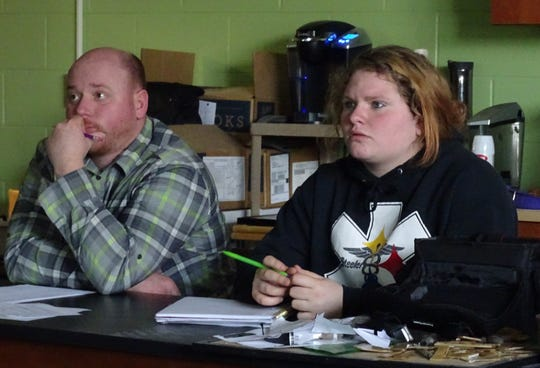 Art teacher Mike Striker and student Breanna Zornes look at photos projected on a screen in the front of the room during a photo editing session on Tuesday at Bucyrus High School.