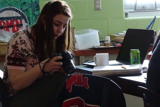 Alexis Pival reviews images in her camera during a photo editing session on Tuesday at Bucyrus High School.