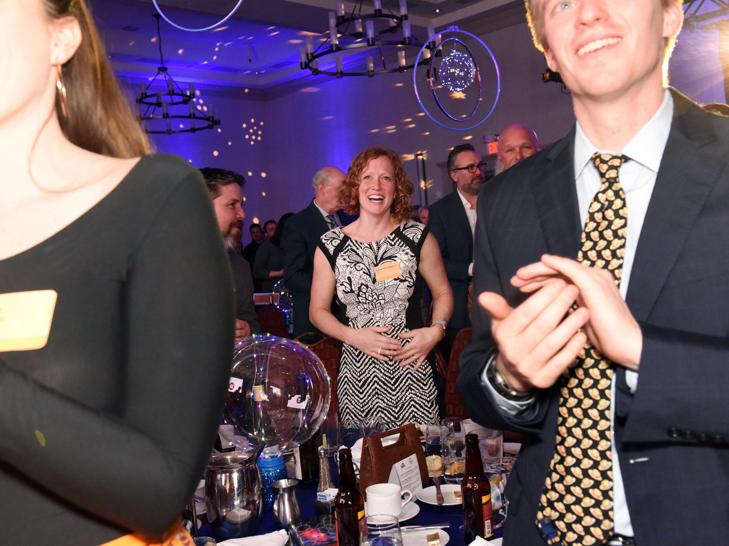 Terra Heilenbach applauds as her husband Justin Heilenbach, co-founder of Citizen Cider, accepts the 2019 Burlington Business Award, presented by Kelly Devine, executive director of the BBA, at the 41st BBA Burlington Business Association Dinner & Annual Meeting at the Hilton Burlington Lake Champlain in Burlington, VT on Thursday, April 4, 2019.