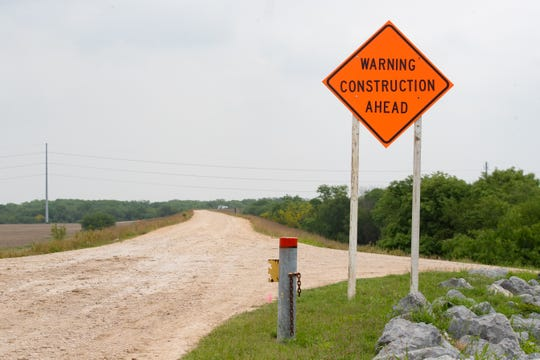 "A sign that reads ""Warning Construction Ahead"" along a levee in Hidalgo County, Texas on Friday, April, 5, 2019. Construction of 13 miles of border fence is scheduled to start."