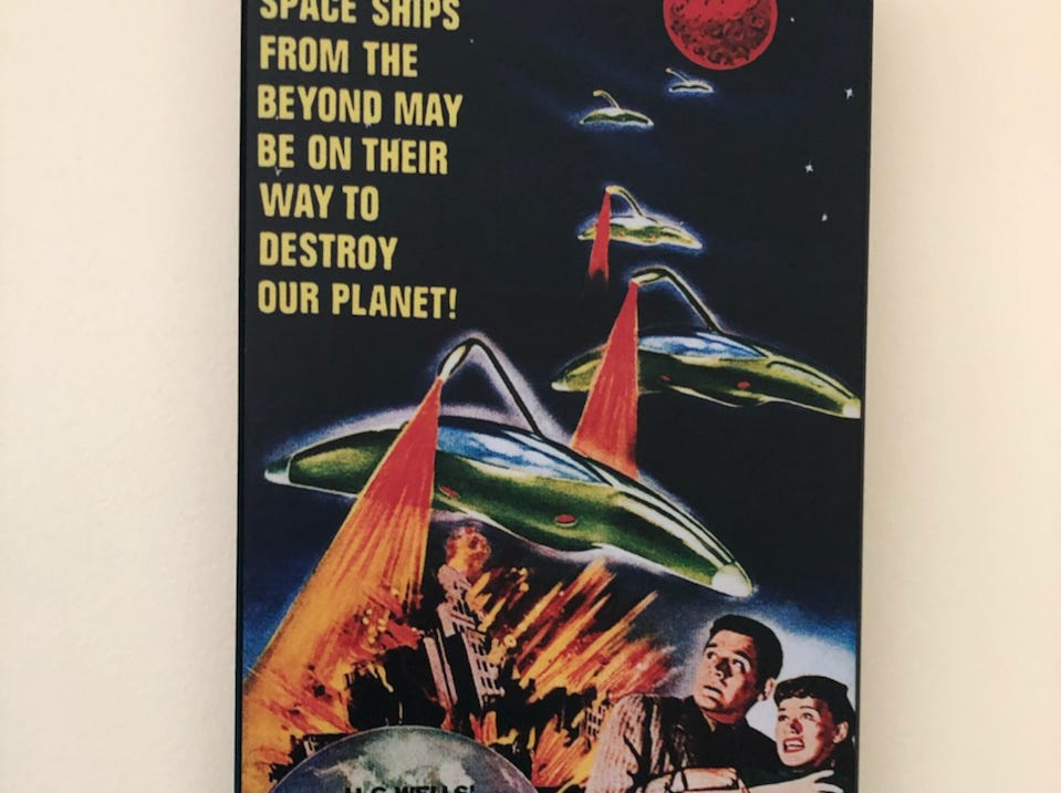 Wall art of 'The War of the Worlds' poster is among the classic movie decor in Alex and Jonathan Chapman's Cherry Hill home.