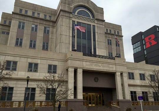A North Jersey woman pleaded guilty Friday to making bomb threats at the federal courthouse in Camden.