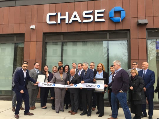 Camden Mayor Frank Moran prepares to cut the ribbon at the Chase Bank branch on Federal Street in Camden. It's the first Chase branch to open in the Philadelphia region.