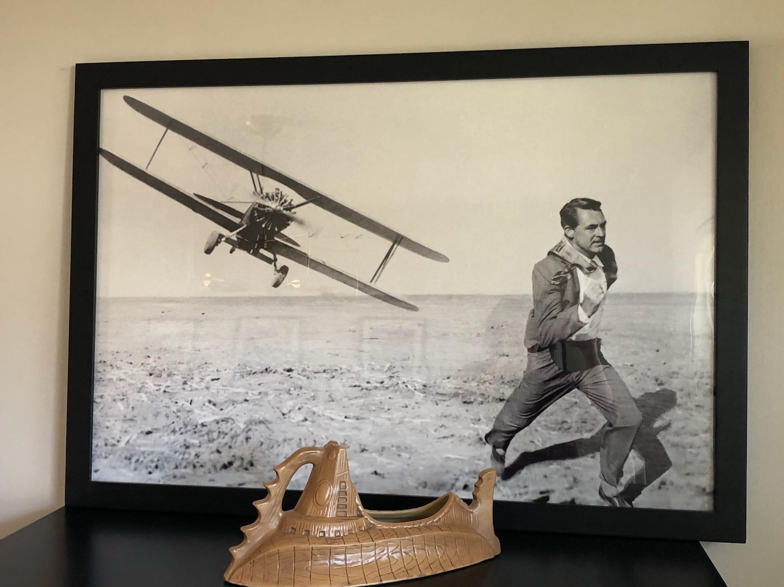 Art from an iconic scene in 'North by Northwest' starring Cary Grant adds a classic touch to Alex and Jonathan Chapman's Cherry Hill dining room.