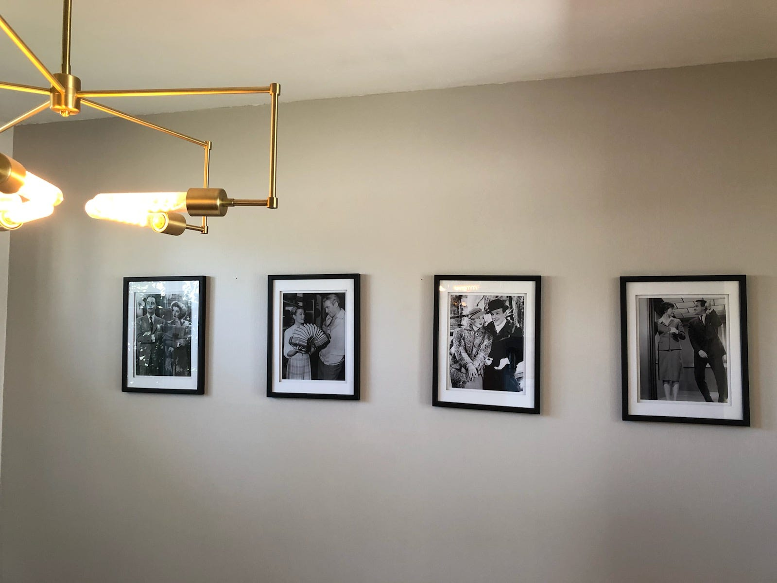 Famous scenes from old movies line a dining-room wall at Alex and Jonathan Chapman's Cherry Hill home.
