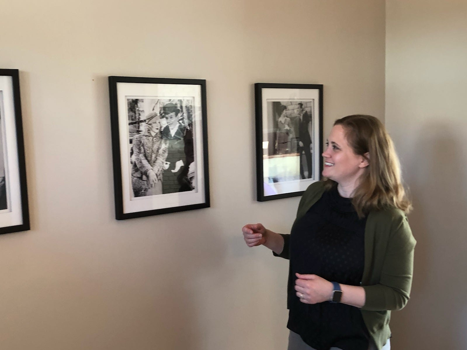 Alex Chapman looks at a photo of Ginger Rogers and Fred Astaire in her Cherry Hill home. She and her husband, Jomathan, have a passion for classic movies.
