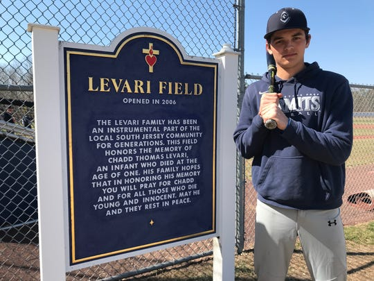 St. Augustine junior Kenny Levari stands next to the Levari FIeld sign at the Prep. Levari plays his home game on a field named after his uncle.