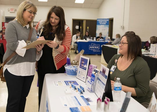 Jami Easterday learns what resources are available in the community for those who are victims of sexual assault as she visited multiple booths at Carver Community Center on Friday, April 5, 2019.