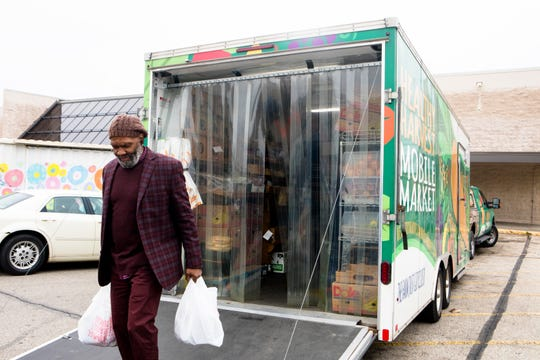 The Healthy Harvest Mobile Market, a program of the Freestore Foodbanks, stops for two hours on Friday afternoons in the parking lot of the former Kroger store on McMillan Street in Walnut Hills.