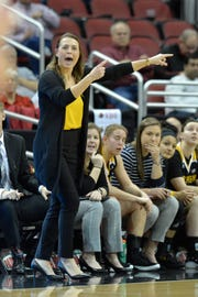 Northern Kentucky women's basketball coach Camryn Whitaker signals a play to her team during the first half of a game at Louisville in December 2018.