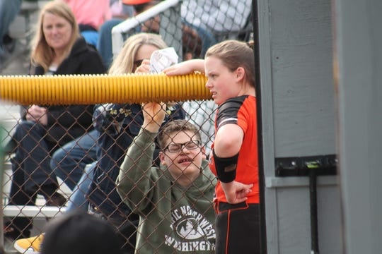 Anderson's Tori Madden speaks to fan club members outside of the dugout during their game with Western Brown April 4.