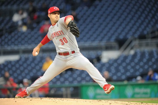 Cincinnati Reds starting pitcher Tyler Mahle (30 delivers a pitch in the first inning against the Pittsburgh Pirates at PNC Park.